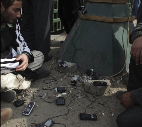 egyptian protestors recharging mobile phones